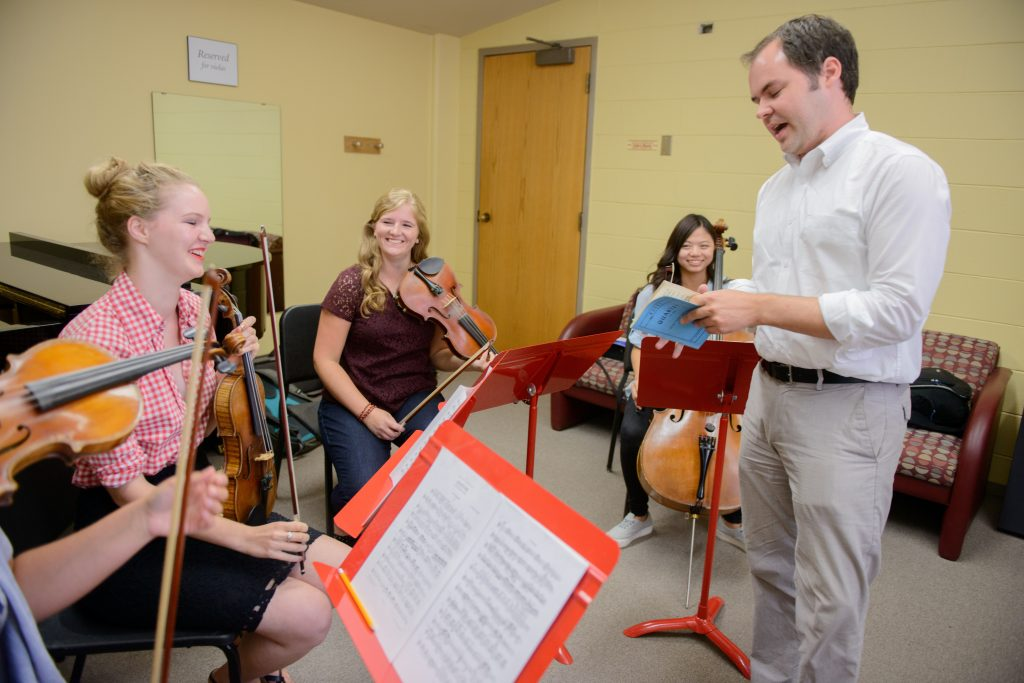 students practicing viola in class
